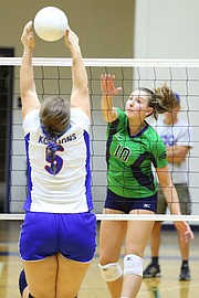 Bishop Seabury Academy's Lindsey Hornberger (10) sends the ball through outstretched arms of KC East Christian Academy's Hannah Landwehr on Thursday, Oct. 15, 2015, at Seabury.