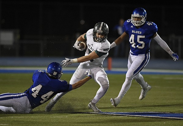Lawrence Free State's Sam Skwarlo stiff arms Washburn Rural's Braeden Ingold to break free Friday.