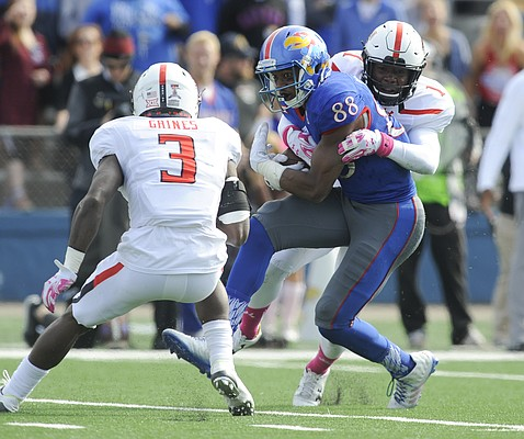 Kansas wide receiver Jeremiah Booker (88) is wrapped up by Texas Tech defensive back Nigel Bethel (1) and defensive back J.J. Gaines (3) during the second quarter on Saturday, Oct. 17, 2015 at Memorial Stadium.