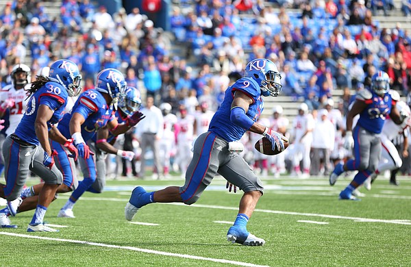 Kansas safety Fish Smithson (9) returns a fumbled ball by Texas Tech deep into the Red Raiders' territory during the fourth quarter on Saturday, Oct. 17, 2015 at Memorial Stadium.
