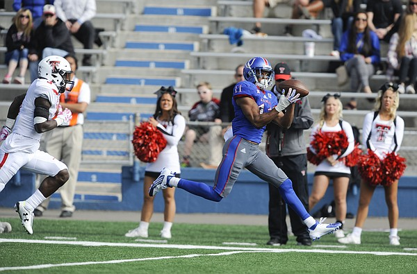 Kansas wide receiver Tre' Parmalee (11) pulls in a pass off his fingertips as he runs it in for a touchdown during the fourth quarter on Saturday, Oct. 17, 2015 at Memorial Stadium.