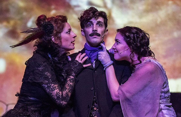 "Cast members, from left, Kirsten Paludan, Devin Burns and Marah Melvin run through a scene during a dress rehearsal for ""Midnight Visit to the Grave of Poe: A Grotesque Arabesque"" on Tuesday, Oct. 20, 2015 at the Lawrence Arts Center, 940 New Hampshire St."