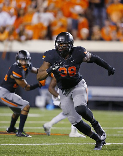 Oklahoma State defensive end Emmanuel Ogbah (38) is pictured during an NCAA college football game between Central Arkansas and Oklahoma St in Stillwater, Okla., Saturday, Sept. 12, 2015. (AP Photo/Sue Ogrocki)
