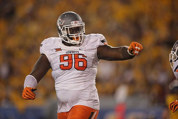 Oklahoma State defensive tackle Vincent Taylor (96) during the first half/ second half of an NCAA college football game, Saturday, Oct. 10, 2015, in Morgantown, W.Va. (AP Photo/Raymond Thompson)