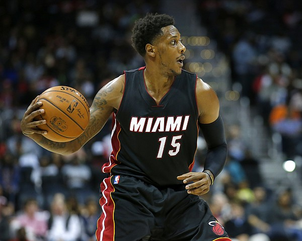 Miami Heat guard Mario Chalmers (15) looks to pass in the second half of a preseason NBA basketball game against the Atlanta Hawks on Sunday, Oct. 18, 2015, in Atlanta. The Heat won the game 101-92. (AP Photo/Todd Kirkland)