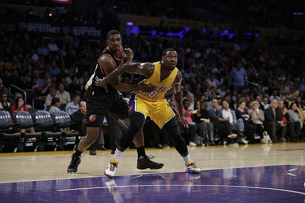 Portland Trail Blazers' Noah Vonleh, left, and Los Angeles Lakers' Tarik Black fight for position during the first half of an NBA preseason basketball game, Monday, Oct. 19, 2015, in Los Angeles. (AP Photo/Jae C. Hong)