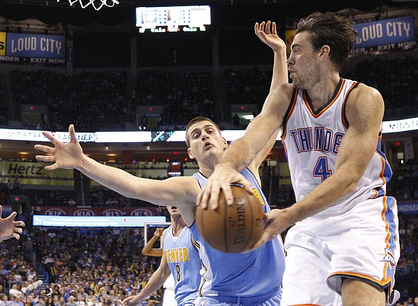 Oklahoma City Thunder forward Nick Collison (4) passes around Denver Nuggets center Nikola Jokic, left, during an NBA basketball preseason game between the Denver Nuggets and the Oklahoma City Thunder in Oklahoma City, Tuesday, Oct. 20, 2015. Oklahoma City won 111-98.(AP Photo/Sue Ogrocki)
