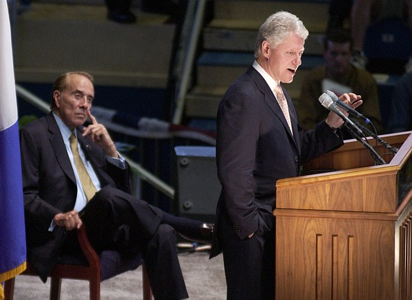In this file photo from May 21, 2004, former President Bill Clinton, right, delivers the inaugural speech in the Dole Lecture Series to about 12,000 people in Allen Fieldhouse as former Sen. Bob Dole looks on.