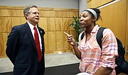 Jeffrey S. Vitter, selected by the state college board as the preferred candidate for Chancellor of the University of Mississippi, speaks with Michelle Wheeler a first year medical student at the University of Mississippi Medical Center, Wednesday, Oct. 28, 2015, in Jackson, Miss.
