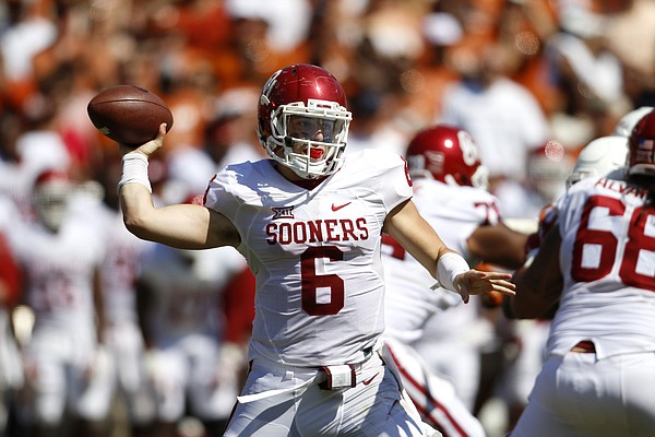 Oklahoma quarterback Baker Mayfield (6) passes against Texas during an NCAA college football game Saturday, Oct. 10, 2015, in Dallas. (AP Photo/Roger Steinman)