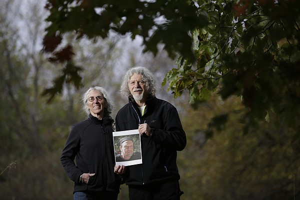 Laurie Ward and Rick Mitchell along with Paul Hotvedt (pictured in photo held by MItchell and currently living in Silver City, N.M.) formed the Committee on Imagination & Place in 1999. The group won a Phoenix Award this year in the Creative Spaces category.