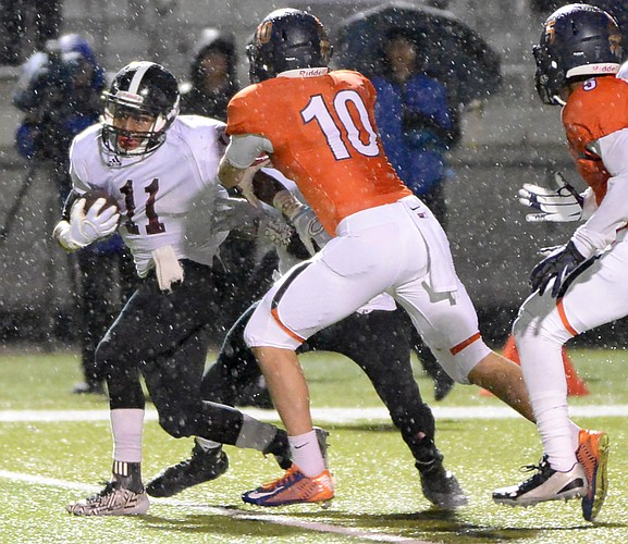 JD woods breaks through on his way to a 96-yard touchdown run as Lawrence High played Olathe East Friday at CBAC.