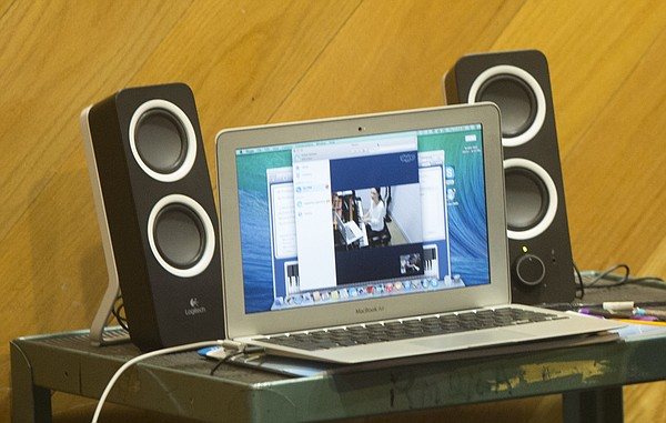 KU music student Isabel Keleti is pictured over a Skype feed while giving a remote piano lesson.