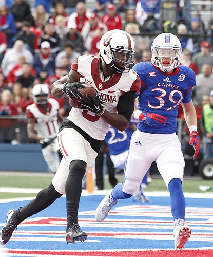 Oklahoma wide receiver Durron Neal (5) pulls in a touchdown catch before Kansas safety Michael Glatczak (39) during the first quarter Saturday, Oct. 31, 2015 at Memorial Stadium.