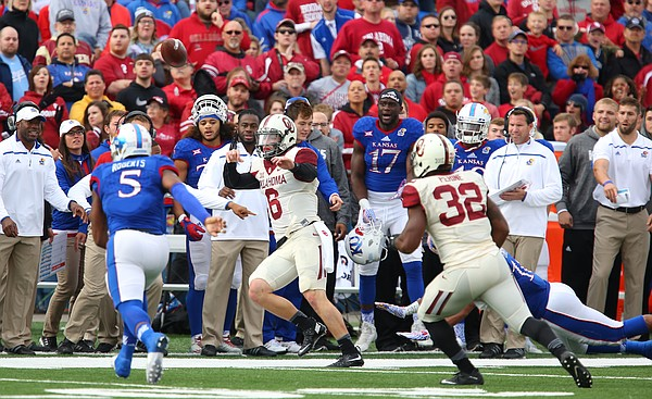 Oklahoma quarterback Baker Mayfield (6) throws a forward pass as he is chased near the Kansas sideline during the second quarter Saturday, Oct. 31, 2015 at Memorial Stadium.