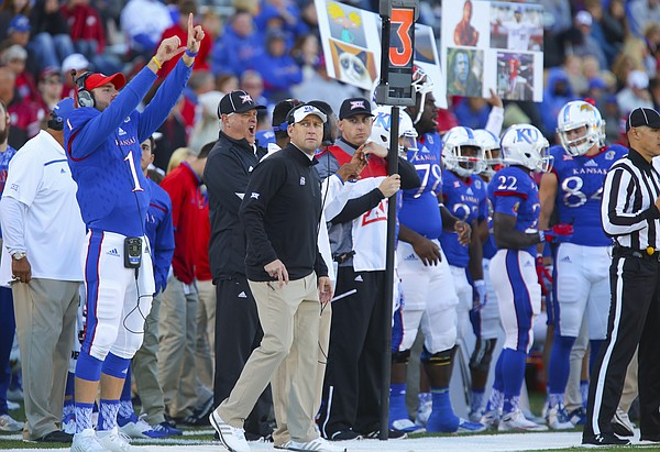 With the game well out of hand Kansas head coach David Beaty looks at the video board during the fourth quarter, Saturday, Oct. 31, 2015 at Memorial Stadium.