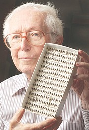 Charles Michener, a retired Kansas University biology professor, displays bees found in the rain forest. He joined in research showing that coffee plants growing near rain forests are better producers, because of the bees' pollinating efforts.