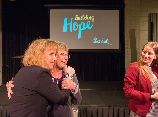 Bert Nash Adult Services Director Amy Warren, left, hugs Eunice Ruttinger, former Adult Services director who retired in September, at the annual Celebrate Bert Nash event Nov. 4 at Maceli's Banquet Hall & Catering.