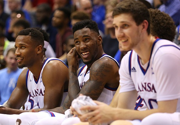 Kansas players Wayne Selden Jr., left, Jamari Traylor and Sviatoslav Mykhailiuk have a laugh on the bench during the second half on Wednesday, Nov. 4, 2015 at Allen Fieldhouse.