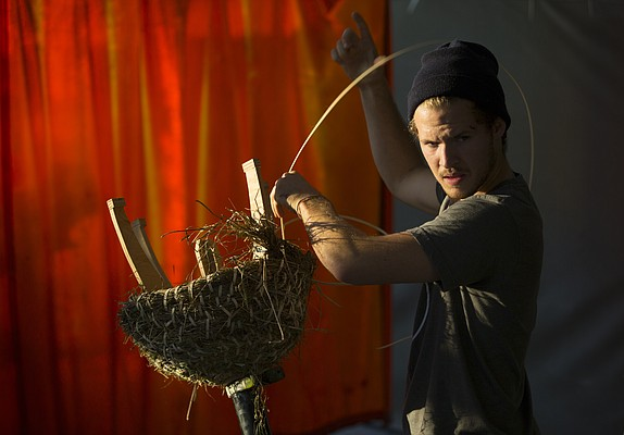 Kansas University senior Jake Kaufmann, of Omaha, Neb., works to tie bundles of straw while constructing a sun hive in Matthew Burke's Social and Sustainable Art Practices class, Tuesday, Nov. 3, 2015, in Chalmers Hall.