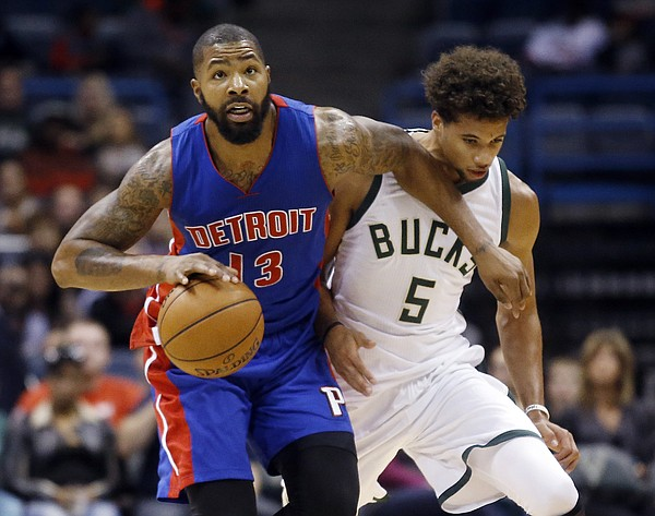 Detroit Pistons' Marcus Morris (13) drives past Milwaukee Bucks' Michael Carter-Williams (5) during the first half of an NBA preseason basketball game Saturday, Oct. 10, 2015, in Milwaukee. (AP Photo/Morry Gash)