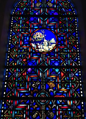 One stained glass window at KU's Danforth Chapel depicts Moses kneeling before the burning bush, an image from the university seal.