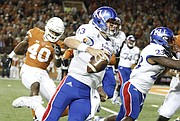Kansas quarterback Ryan Willis (13) tries to cut around the sideline for a touchdown but came up short during the second quarter on Saturday, Nov. 7, 2015 at Darrell K. Royal Stadium in Austin, Texas.