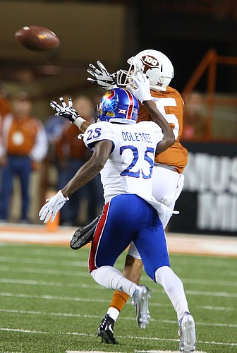 Texas wide receiver Lorenzo Joe (5) catches a deep pass beyond Kansas cornerback Marnez Ogletree (25) during the first quarter on Saturday, Nov. 7, 2015 at Darrell K. Royal Stadium in Austin, Texas.