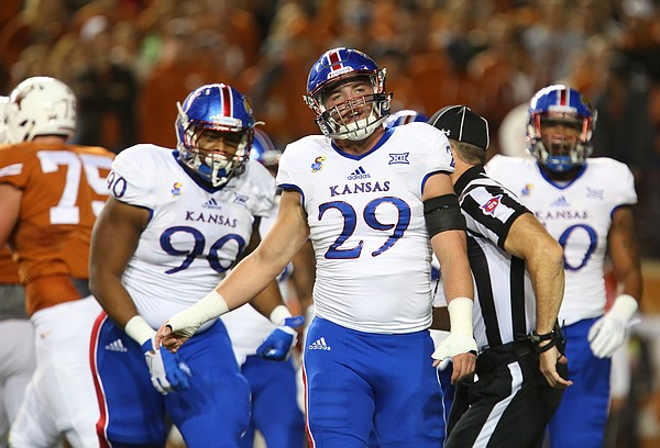 A frustrated Kansas linebacker Joe Dineen Jr. (29) shows turns away after a Texas touchdown during the first quarter on Saturday, Nov. 7, 2015 at Darrell K. Royal Stadium in Austin, Texas.