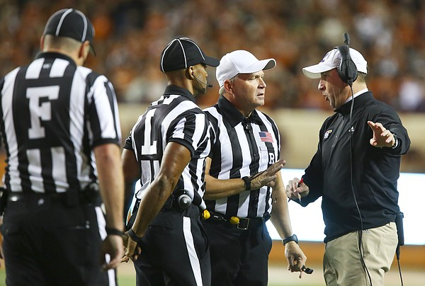 Kansas head coach David Beaty argues with officials during the second quarter on Saturday, Nov. 7, 2015 at Darrell K. Royal Stadium in Austin, Texas.