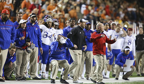 Kansas head coach David Beaty and the Jayhawk bench react to a missed field goal with seconds remaining in the second quarter on Saturday, Nov. 7, 2015 at Darrell K. Royal Stadium in Austin, Texas.