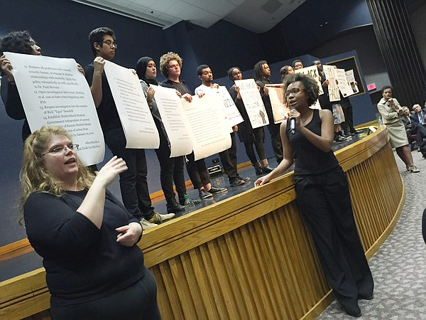 A group of students identifying itself as Rock Chalk Invisible Hawk takes the stage and reads a list of diversity and inclusion related demands for Kansas University during KU's town hall forum on race Wednesday, Nov. 11, 2015, at Woodruff Auditorium in the Kansas Union, as KU Chancellor Bernadette Gray-Little, far right, who was moderating the forum, looks on. Sign language interpreter Kim Bates, left, translated throughout the event.