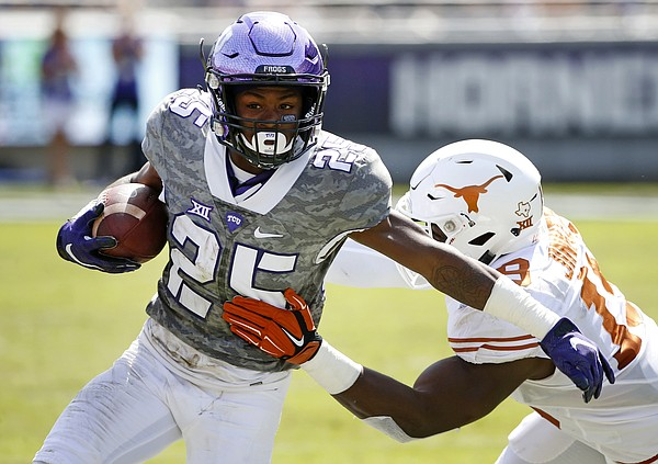 TCU wide receiver KaVontae Turpin (25) tries to get outside of Texas linebacker Peter Jinkens (19) in the second half of an NCAA football game Saturday, Oct. 3, 2015, in Fort Worth, Texas. (AP Photo/Ron Jenkins)