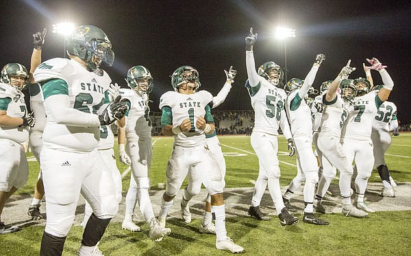 Free State players celebrate following their 52-34 victory over Wichita Northwest Friday night in Wichita.
