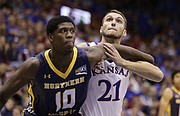 Kansas forward Clay Young (21) and Northern Colorado forward Ibrahim Sylla (10) fight for position during the second half, Friday, Nov. 13, 2015 at Allen Fieldhouse.
