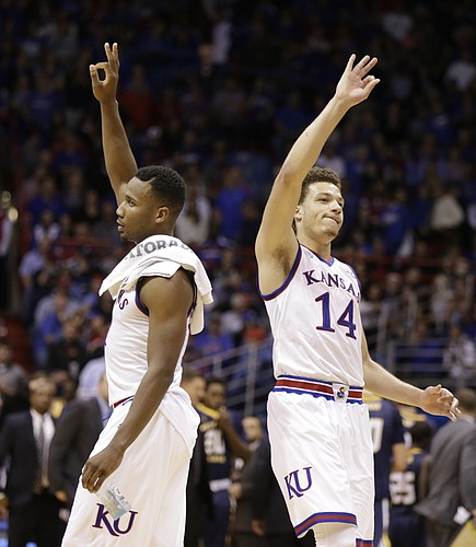 Kansas guard Brannen Greene (14) and Kansas guard Wayne Selden Jr., left, celebrate a three by Greene during the second half, Friday, Nov. 13, 2015 at Allen Fieldhouse.