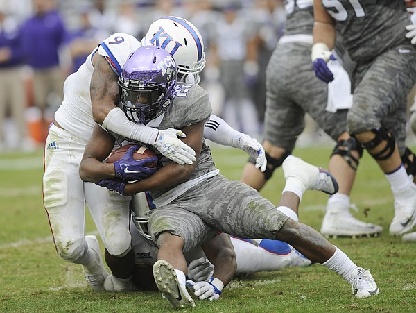 KU junior Fish Smithson (9) wraps up TCU's Aaron Green (22) for a loss in the Jayhawks' 23-17 loss to TCU on Saturday, Nov. 14, 2015, in Fort Worth, Texas.