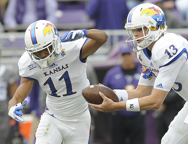KU senior Tre' Parmalee (11) gets set for a handoff from quarterback Ryan Willis in the Jayhawks' 23-17 loss to TCU on Saturday, Nov. 14, 2015, in Fort Worth, Texas.
