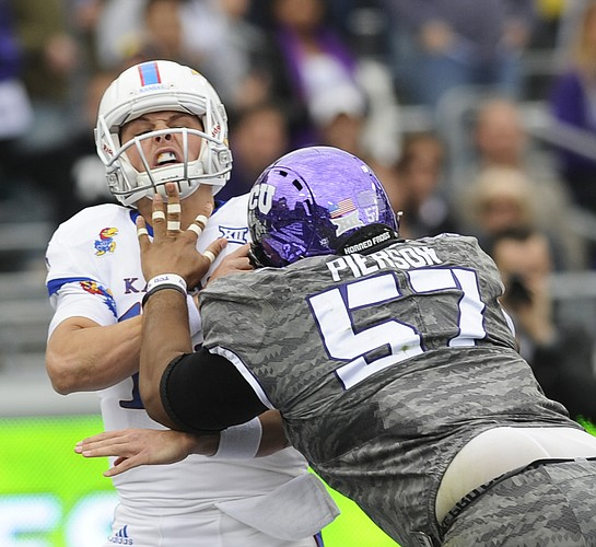 Kansas QB Ryan Willis (13) gets sacked by TCU's Davion Pierson in the Jayhawks' 23-17 loss to TCU on Saturday, Nov. 14, 2015, in Fort Worth, Texas.