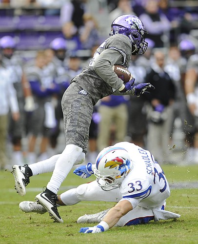 Kansas' Ryan Schadler (33) tries to take down TCU's KaVontae Turpin in the Jayhawks' 23-17 loss to TCU on Saturday, Nov. 14, 2015, in Fort Worth, Texas.