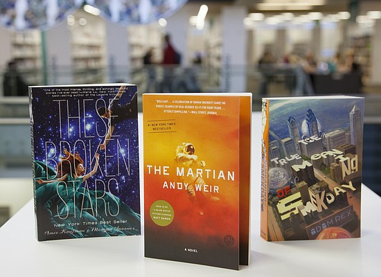 "The 2016 Read Across Lawrence event will feature, from left, ""These Broken Stars,"" by Amie Kaufman (for teens), ""The Martian,"" by Andy Weir (for adults) and ""The True Meaning of Smekday,"" by Adam Rex (for children)."
