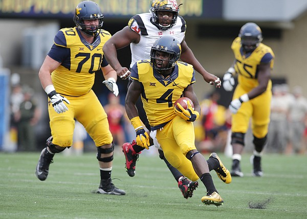 West Virginia running back Wendell Smallwood breaks into the secondary during the Mountaineers' 45-6 win over Maryland on Sept. 26 in Morgantown, West Virginia.