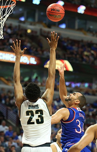 Kansas forward Perry Ellis (34) turns for a shot over Michigan State forward Deyonta Davis (23) during the first half, Tuesday, Nov. 17, 2015 at United Center in Chicago.