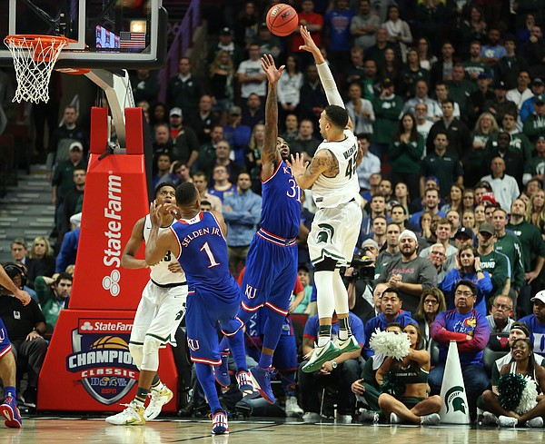 Michigan State guard Denzel Valentine (45) puts a shot up over Kansas forward Jamari Traylor (31) late in the second half, Tuesday, Nov. 17, 2015 at United Center in Chicago.