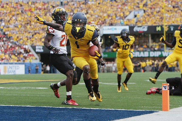 West Virginia wide receiver Shelton Gibson (1) beats Maryland defensive back Sean Davis (21) to the end zone during the first half of an NCAA college football game, Saturday, Sept. 26, 2015, in Morgantown, W.Va. (AP Photo/Raymond Thompson)