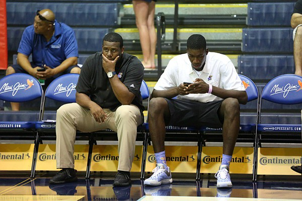 Kansas University freshman Cheick Diallo sits on the bench with assistant coach Jerrance Howard before the start of the Jayhawks' opening-round game at the Maui Invitational, against Chaminade, on Nov. 23, 2015.