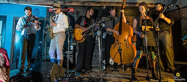 Members of Cowgirl's Train Set record music at 9th Ward Pickin' Parlor