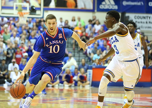 Kansas guard Sviatoslav Mykhailiuk (10) drives against UCLA guard Aaron Holiday (3) during the first half, Tuesday, Nov. 24, 2015 at Lahaina Civic Center in Lahaina, Hawaii.