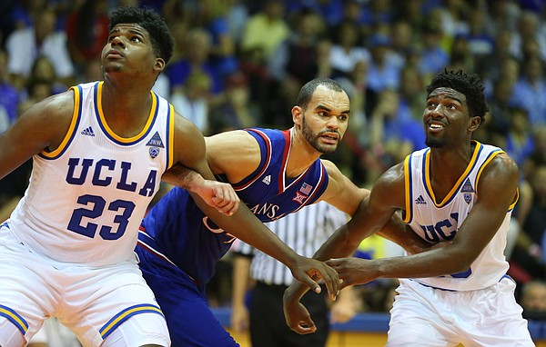 Kansas forward Perry Ellis (34) works against UCLA forward Tony Parker (23) and UCLA guard Isaac Hamilton during the second half, Tuesday, Nov. 24, 2015 at Lahaina Civic Center in Lahaina, Hawaii.