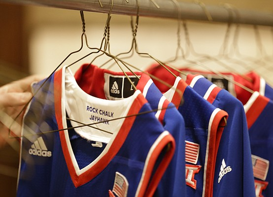 Managers pull jerseys from a rack after a night of air drying as they are organized into bundles for the players, Tuesday, Nov. 24, 2015 at the Westin Maui in Lahaina, Hawaii.